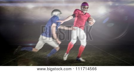 American football players against sports pitch