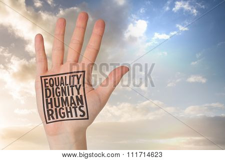 Hand with fingers spread out against scenic view of blue sky