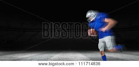 American football player holding ball in mid-air against rugby stadium