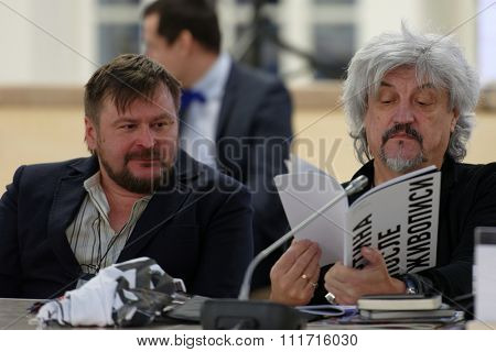 ST. PETERSBURG, RUSSIA - DECEMBER 13, 2015: Artists Sergey Shekhovtsov (left) and Alexander Ponomarev at the round table discussion during 4th St. Petersburg International Cultural Forum