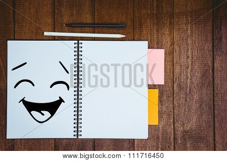 Smiling face against close up view of a workbook