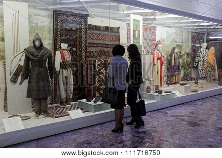 ST. PETERSBURG, RUSSIA - DECEMBER 14, 2015: Women watching the exposition in the Russian Museum of Ethnography during 4th St. Petersburg Cultural Forum. Business venue's events were held here