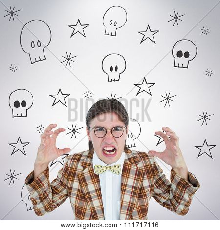 Furious geeky hipster looking at camera against grey background