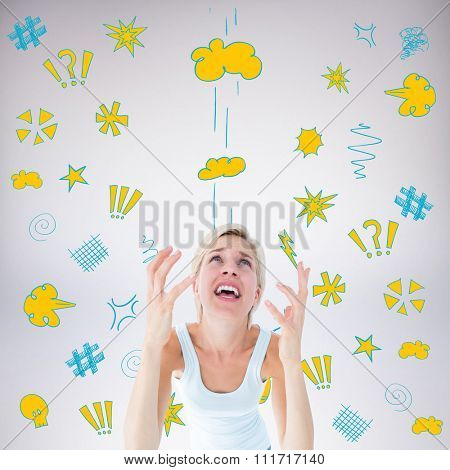 Upset woman yelling with hands up against grey background