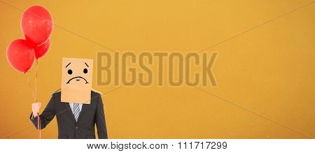 Anonymous businessman against orange background