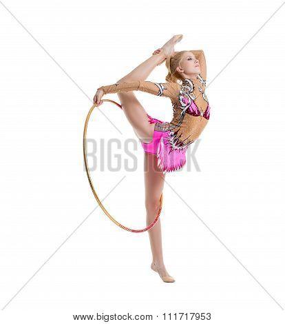 Flexible gymnast dancing with hoop in studio