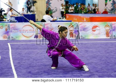 JAKARTA, INDONESIA - NOVEMBER 17, 2015: Ayaka Honda of Japan performs the movements in the women's Jianshu event at the 13th World Wushu Championship 2015 in Istora Senayan Stadium.