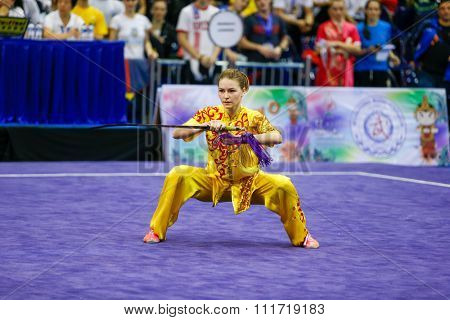 JAKARTA, INDONESIA - NOVEMBER 17, 2015:Liudmyla Temna of Ukraine performs the movements in the women's Jianshu event at the 13th World Wushu Championship 2015 in Istora Senayan Stadium.
