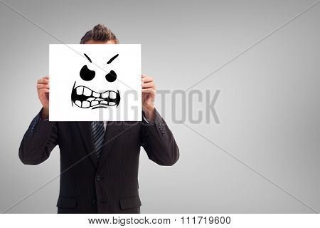 Businessman holding a white card in front of his face against white background with vignette