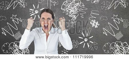 Portrait of screaming businesswoman clanching fists against grey room