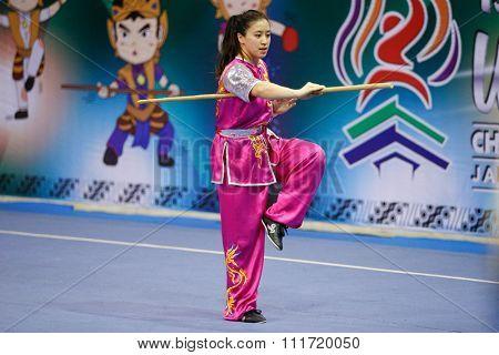 JAKARTA, INDONESIA - NOVEMBER 17, 2015: Elizabeth Lim of Australia performs the movements in the women's Nangun event at the 13th World Wushu Championship 2015 in Istora Senayan Stadium.