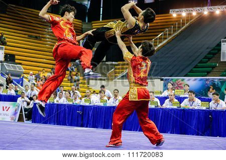 JAKARTA, INDONESIA - NOVEMBER 17, 2015: The South Korea team performs the action fights in the Men's Duel event at the 13th World Wushu Championship 2015 in Istora Senayan Stadium.