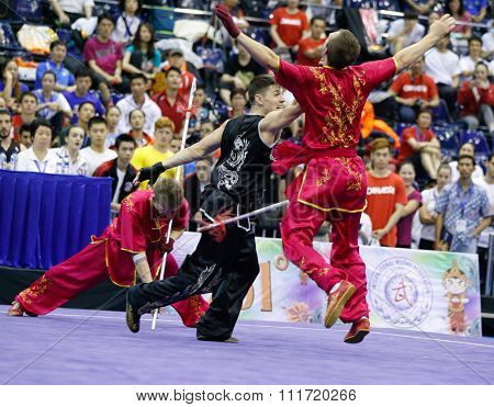 JAKARTA, INDONESIA - NOVEMBER 17, 2015: The Ukraine team performs the action fights in the Men's Duel event at the 13th World Wushu Championship 2015 in Istora Senayan Stadium.