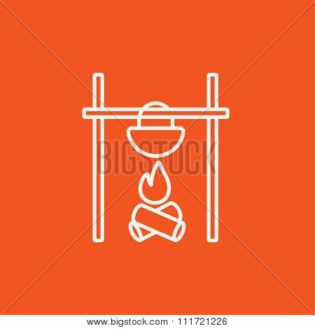 Cooking in cauldron on campfire line icon for web, mobile and infographics. Vector white icon isolated on red background.