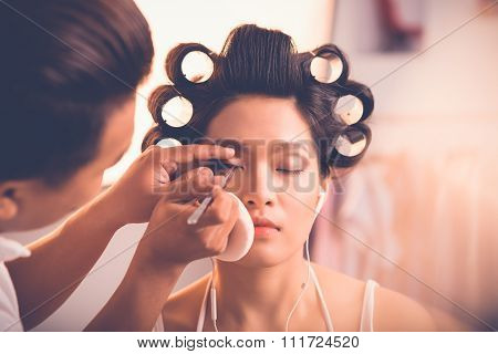 Applying false lashes