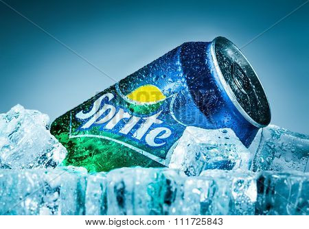MOSCOW, RUSSIA-APRIL 4, 2014: Can of Coca Cola company soft drink Sprite on ice. It was introduced in the United States in 1961. This was Coke's response to the popularity of 7 Up.