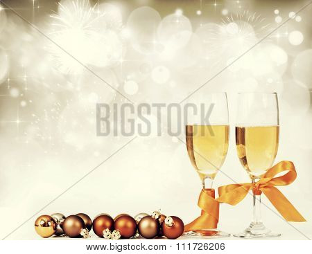 Glasses with champagne against fireworks an holiday lights