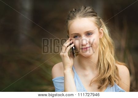 Beautiful blond girl talking on cell phone