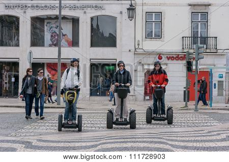 Lisbon, Portugal March 24, 2013: Tourist group having guided Segway city tour in Lisbon
