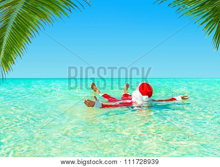 Santa Claus Swimming In Tropical Ocean Water, Christmas Relax Concept