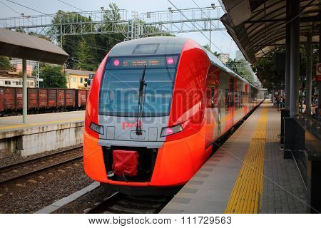 SOCHI, RUSSIA - AUG, 4, 2014: High speed train Lastochka in summer day. Produced by Siemens AG, train can reach speeds up to 160 km/h.