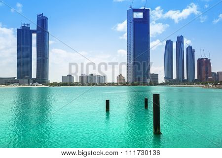 ABU DHABI, UAE - 27 MARCH 2014: Cityscape of Abu Dhabi at Persian Gulf, UAE. Abu Dhabi is the capital and the second most populous city in the United Arab Emirates with around 1 million people.