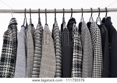 female Variety of coat clothing on hangers