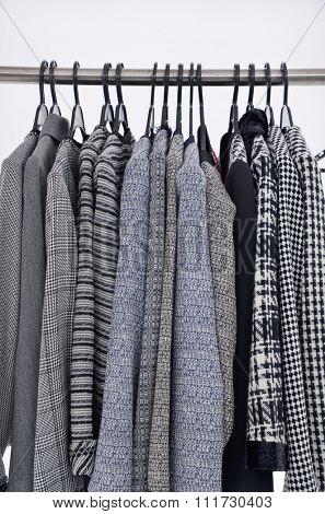 Set of female coat clothing on hangers