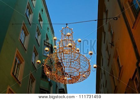 Night view of one of the Christmas Lights, a huge Chandelier hanging to decorate street in Innsbruck, Austria