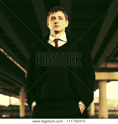 Young business man under highway road intersection