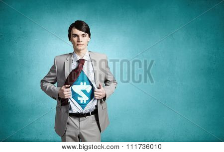 Businessman with dollar sign on chest acting like superhero