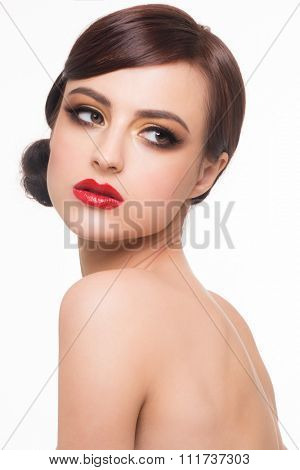 Portrait of young beautiful woman with fashion makeup. Makeup with golden eyeshadow and red lips