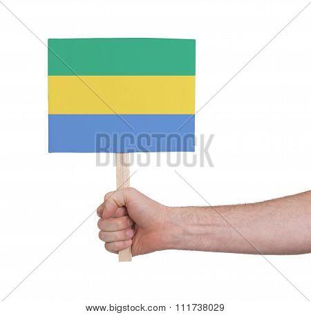 Hand Holding Small Card - Flag Of Gabon