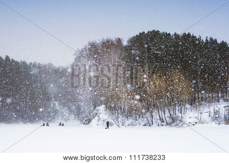 Winter fishing in Siberia snowfall