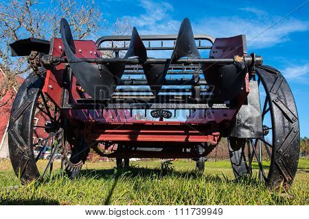 Old Antique Tractor Stands In Grass Field
