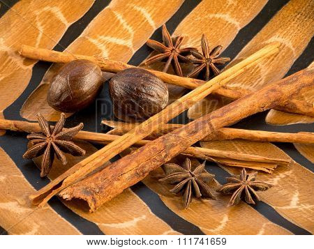 Cinnamon, Star Anise And Nutmeg On The Wooden Background