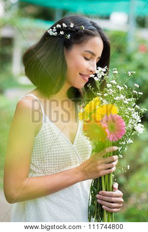Charming woman with flowers