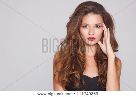 Beautiful natural curly blonde hair, portrait of an young girl