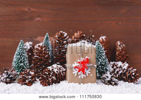 Christmas And New Year Background With Snow, Pinecones, Present With Red Fir Tree. Place For Text.