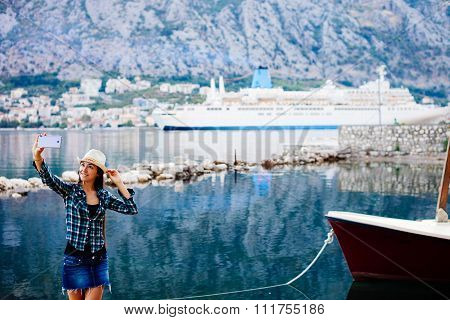Girl Taking Selfie Photo On Smartphone Of Cruise Liner Yacht
