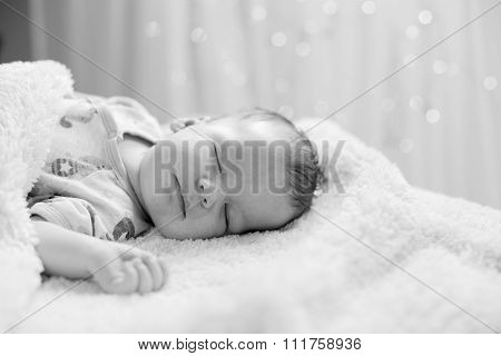 Newborn Sleeping On Back