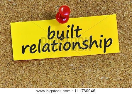 Built Relationship Word On Yellow Notepaper With Cork Background