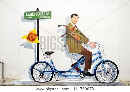A Mural Of The Famous Mr. Bean Character On A Bicycle