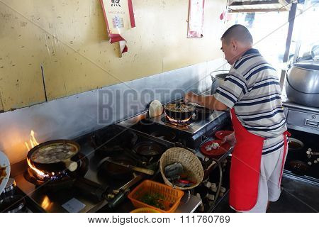 Chef Prepares A Stew Of Pork And Herbal Soup, Ba Kut Teh In Tanjung Sepat, Malaysia