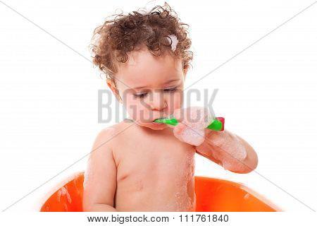 Baby Brushing Teeth In Bath