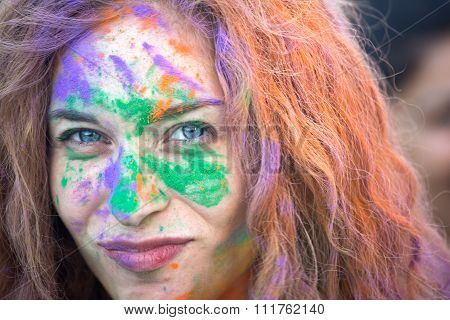 Naples, Italy, September 12 2015: Holi Festival Of Colors. A Participant Covered With Color Powder.