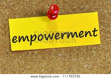 Empowerment Word On Yellow Notepaper With Cork Background