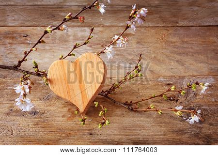 Heart Shape Of Wood With Blooming Branches On A Rustic Wooden Background, Love Symbol