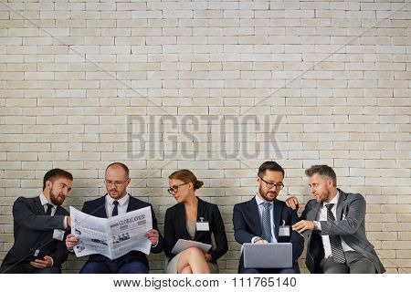 Modern business people discussing new vacancies