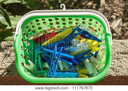 Colored Plastic Clothespins In A Basket
